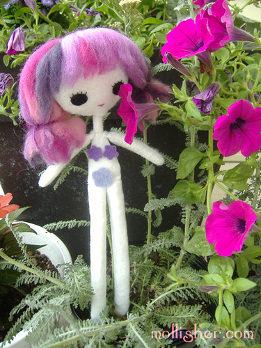 Felt girl in the front garden