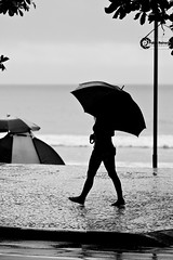 Walking in the rain... photo by Pablin79
