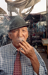 Smoking Xinjiang tobacco photo by Woods | Damien