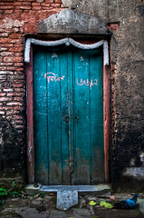 closed door and a pigeon!! photo by swarat_ghosh