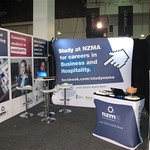 NZMA portable exhibition kit. Using Waveline B display wall, exhibition brandwalls and portable tables