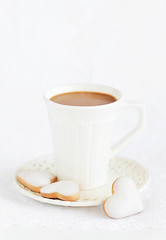 A cup of hot cocoa and homemade white chocolate frosting cookies photo by laperla2009