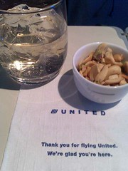Nuts in a porcelain cup - and ginger ale on an airplane