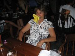 Paula eating hibiscus, Kimo's Maui 07.06 122