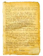 Ein alter Brief fällt hinter einem Rahmen hervor