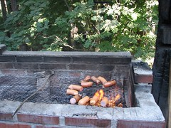 Sausages on a brick barbeque