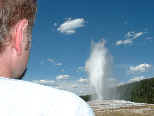 Rob watches Old Faithful