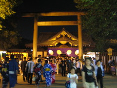 A kind of typical shot of a temple and people there for a festival