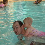 having a piggy back at baby swimming<br/>17 Sep 2005