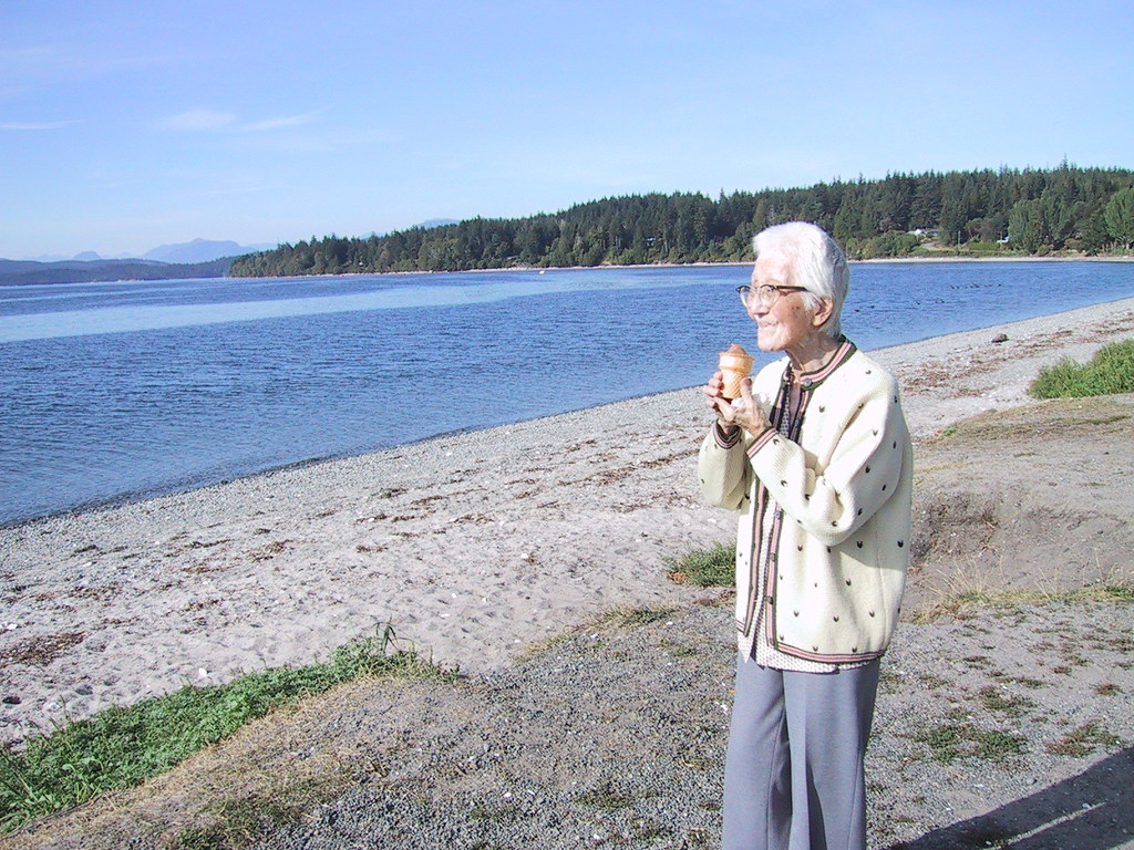 Ruth's mom eating ice cream on a northern beach