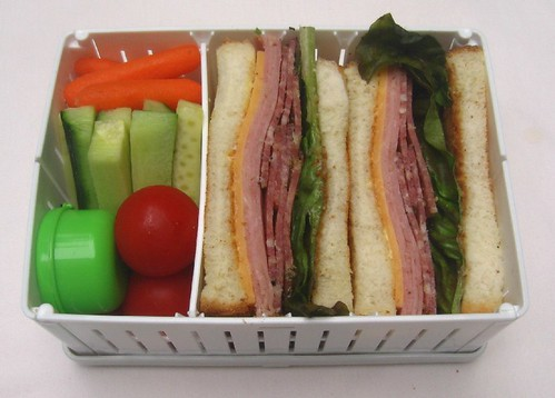 Mixed meat sandwich in collapsible sandwich holder