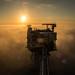 Sunrise, Cloud Inversion and Oil Platform