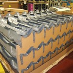 PCA's unique cowl plenum packaging uses corrugated blocks to support and separate stampings.