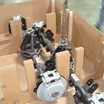 This rear axle assembly package uses corrugated blocks to support the axles and wood posts for stabilization.