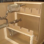This exhaust assembly package uses corrugated blocks to support parts, and a triplewall outer sleeve provides maximum strength.