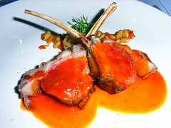 Grilled rack of lamb served with seasonal vegetables and thyme jus