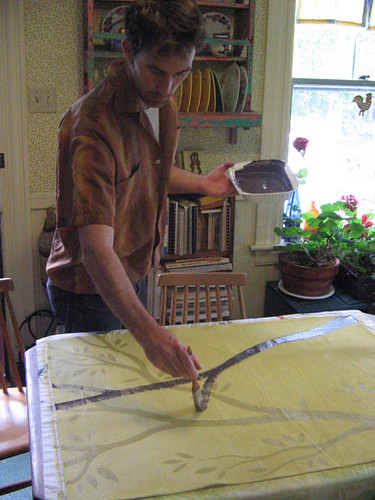 hugh painting a floor cloth