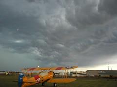 Biplane under storm clouds