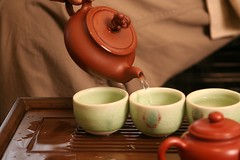 Pouring the tea into the tea cups