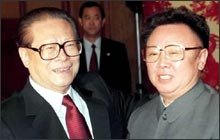 Kim Jong Il meets China's most powerful has-been (AP photo).