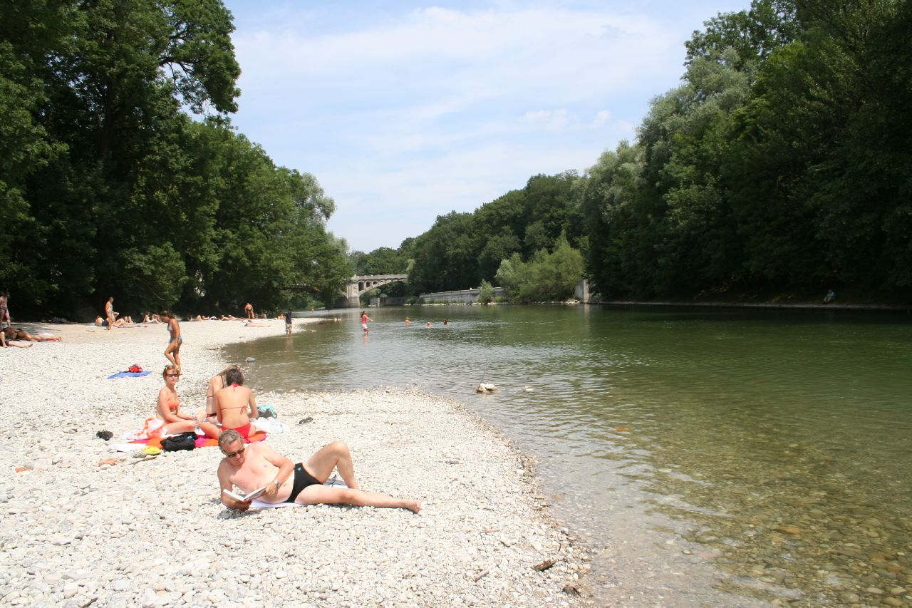 Sunbathing (clothing optional) is frequent on the river that runs
