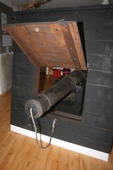 A fully conserved gun fromm the wreck on display in the Alderney Museum.  The port and cladding timbers are modern