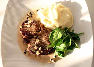 Steak with Pepper Sauce with Mashed Potatoes and Wilted Spinach