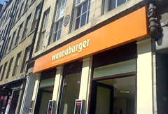 Exterior sign above Wannaburger on Edinburgh's Royal Mile