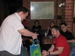 Jukka giving the goodie bag to Jeff VanderMeer
