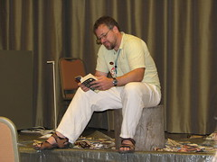 Jeff VanderMeer reading amidst the rubble from the destruction auction