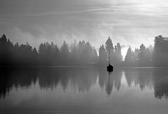 Lonely on the water - monochrome photo by Derek Lyons