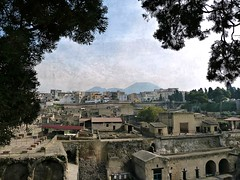 excavations of Herculanium with a panoramic view of  Ercolano and Vesuvius photo by jjamv