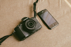 Olympus EM5 vs iPhone 4s photo by ngaiwinghong