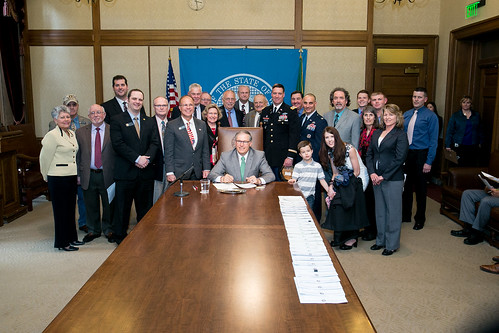 Gov. Jay Inslee signs Substitute House Bill No. 2363, April 2, 2014. Relating to home and community-based services programs for dependents of military service members.