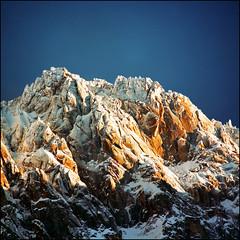 Snow covered Alpine peaks photo by Katarina 2353