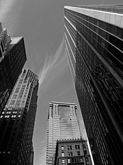 Architecture - skyscrapers and sky, Wall St, NYC_7186 copy photo by wordly images