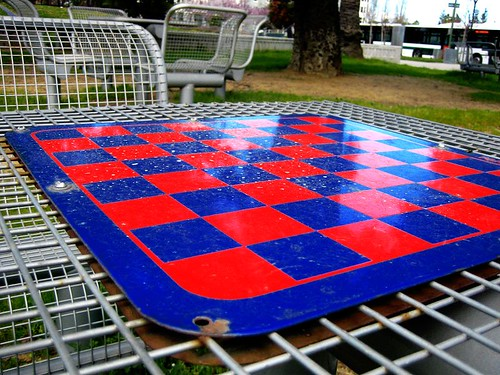 A chessboard awaits potential players in an Oakland park