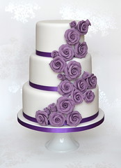 Cascading Purple Roses Wedding Cake photo by madebymariegreen
