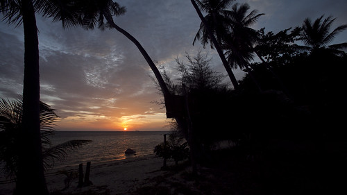 Beach Sunset Timelapse Frame with palm tree silhouettes @ Koh Phangan, Thailand photo by RickyLoca