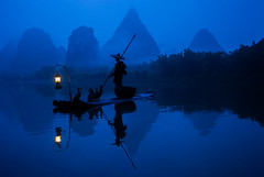 Fisherman on the Li River photo by Greg Annandale