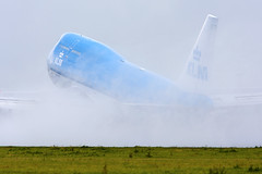 KLM 747-400 Taking off in the rain photo by Tim de Groot - AirTeamImages