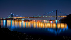 A bridge in the night and the City Lights photo by 10iggie