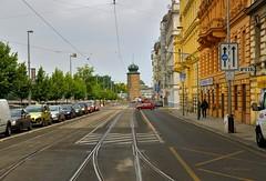 Prague : Street with a red car and the  Štítkovský mill ( tower ) photo by Pantchoa