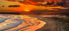 Burning beach at Sunset photo by **James Lee**