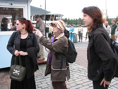 Marianna, Liisa and Pasi waiting for the boat to arrive