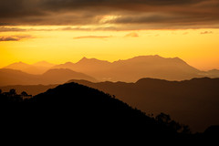 Sunset over Truong Son mountain range in Vietnam photo by anhgemus