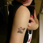 showing off her tattoo<br/>18 Oct 2013