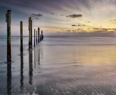 A wavy sunrise photo by Photo by Sammy