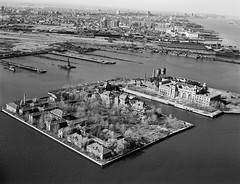 In the 1970s, even Ellis Island was abandoned and overgrown with weeds and trees. The squalid Jersey City waterfront made a perfect background. 1975. photo by wavz13