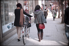 Walking with her bicycle and a friend photo by Eric Flexyourhead